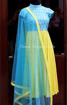 Stunning yellow and sky blue color combination floor length dress with net dupatta. To order pls call or watsapp on Long Dress Design, Dress Neck Designs, Kurti Neck Designs, Stylish Dress Designs, Kurti Designs Party Wear, Churidar Designs, Blouse Designs, Indian Gowns Dresses, Indian Fashion Dresses
