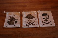 """I did a pirate theme in my yard this year and my lovely bride made some great pirate """"Booty"""" bags by stenciling either a skull & crossbones or a pirate ship on the bags. We are going to fill them with chocolate pirate coins, gummi skull & crossbones and temporary pirate tattoo's. I think they turned out really nice:"""