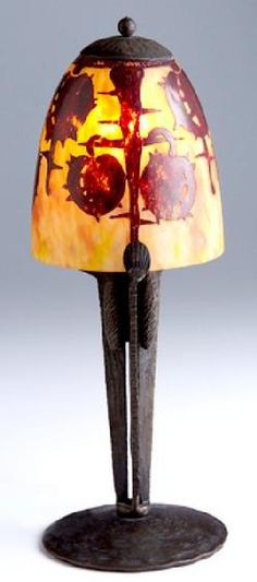 lighting, France, Le Verre Francais glass and bronze boudoir lamp, with pomegranate design shade in red over mottled orange, the base applied with pussy willows, original cap.Signed Circa 1901-1925