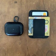 BLACK TO BLACK - Our black leather minimalist wallet with black leather AirPods Pro case. The wallet is super slim but will still hold 8 cards and has a strong magnetic moneyclip to hold cash or receipts. Both can be personalised with a name or initials and come in our neat sustainable packaging. Airpods Pro, Minimalist Wallet, Initials, Hold On, Lunch Box, Black Leather, Packaging, Strong, Slim
