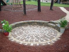New Stone Patio with Retaining Wall & Pathway