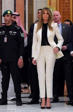 Another change: Ahead of the Arabic Islamic American Summit at the King Abdulaziz Conference Center, Melania was seen dressed in a white pantsuit