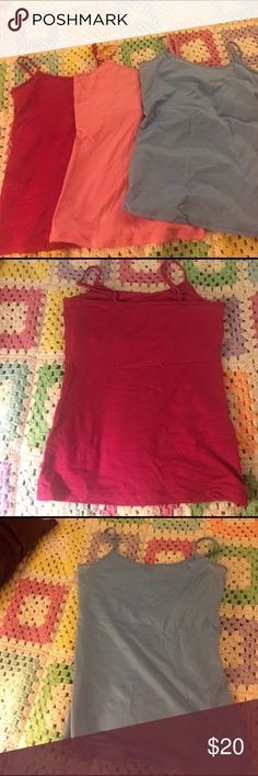 Camis with bra shelfing 3 WHBM spandex and nylon camis w built in bra. 1 cranberry, 1 punk and one nanny blue. White House Black Market Tops Tank Tops