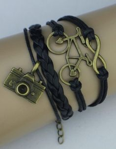 Infinity, Bicycle, Camera Wrap Bracelet – Black  $15.00  Fashion Jewelry at Modest Prices - www.gomodestly.com