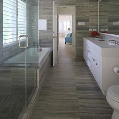 """same tile used on wall, floor, shower.   Palladium 12"""" x 20"""" travertine field in honed-filled finish"""
