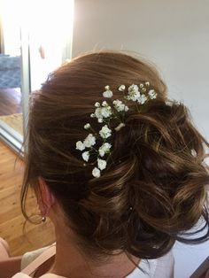 Bridal hair style with the added prettiness of baby's breath, love this timeless style! #hairbyrosie #hairstyle #wedding