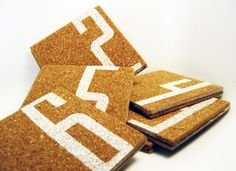 Painting cork coasters. Cheap, cute, and necessary!