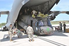 CH-47 Chinook belonging to the Combat Aviation Brigade, 1st Infantry  Division, is loaded onto an Air Force C-17 Globemaster as part of an  Emergency Deployment Readiness Exercise held at Marshall Army Airfield.