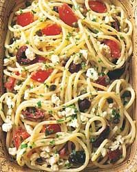 Spaghetti salad with tomatoes, black olives, garlic and feta. an ideal summer pasta with fresh tomatoes as the main attraction. Feta complements the tomatoes beautifully, and the heat of the pasta and hot garlic oil make the cheese meltingly soft.