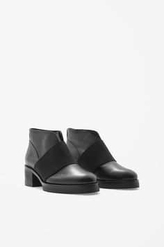 These chunky-heel leather boots have an elastic strap for a modern  contrast. Round e09bfafc3b