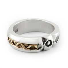 This is a unique wedding band handcrafted by Navajo artist, Jennifer Curtis. It is fashioned out of Sterling Silver and 14K Yellow Gold.
