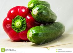 Photo about Soft focus of fresh red pepper and green zucchini on a white background - capsicum, cocurbita pepo. Image of ingredient, natural, vitamin - 112353253