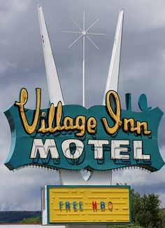 Village Inn Motel Vintage neon sign.