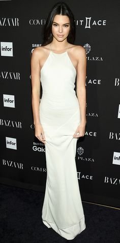 Kendall Jenner took a break from runway to rule the red carpet in a sleek, minimalist ivory silk bias-cut Calvin Klein Collection gown—the work of creative director Francisco Costa.