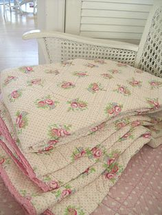 Old floral quilt on chenille bedspread