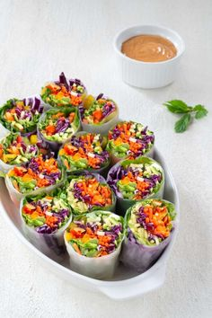 Spring rolls filled with crunchy veggies, fresh herbs, and vermicelli noodles. Serve with a peanut lime sauce for a satisfying meal. Veggie Rolls, Veggie Spring Rolls, Fresh Spring Rolls, Summer Rolls, Fresh Rolls, Entree Recipes, Vegetarian Recipes, Healthy Recipes, Spring Roll Peanut Sauce