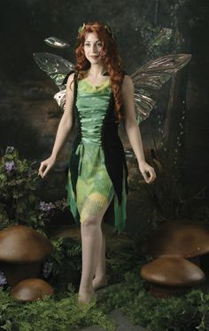 "Forest Fairy costume. Solid color slip, sheer ""tie-died"" layer, and deep emerald green stretch velvet corset style overdress with ribbon lacing. Lacing in both the front and the back makes this dress adjustable.  Good idea for making my own"