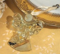 Murano art deco collection angel ornament - Stunning Murano style glass angel ornament. A unique favor idea by Cassiani collection, a handcrafted glass angel ornament made of an array of unique fused glass in gold and cream colors with clear and black accents. http://www.favorfavorbaby.com/p-DC5122.htm