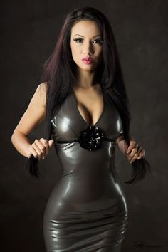 Beautiful Asian in shiny latex, luscious lips too:-)