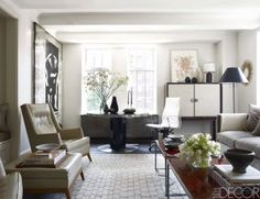 The living room of designer Douglas Durkin's Manhattan apartment, which he renovated with architect Kurt Melander. The 1948 leather armchair and ottoman are by T. H. Robsjohn-Gibbings, the sofa by Carlyle is covered in a Rose Tarlow Melrose House linen, the cocktail tables are 19th-century Chinese lacquer tops on French 1940s steel bases, and the 1970s occasional table is by Willy Rizzo; the painting is by Charley Brown, a watercolor by Andrew Belschner rests on a cabinet by Paul Frankl, the…