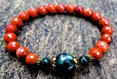 This elegant bracelet was made of natural seraphinite, faceted red jasper, green peacock jasper and gold plated beads . It brings protection, justice, good luck and ward off evil spirit or evil eye. Seraphinite has impressive attributes for physical and emotional healing.