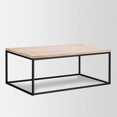 Timber topped. An easy fit with any style, the Box Frame Coffee Table's metal base is topped with a slab of mango wood. Mango wood top. Antique Bronze-finished steel frame. Made in India.