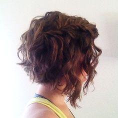 Curly/wavy angled bob.                                                                                                                                                     More