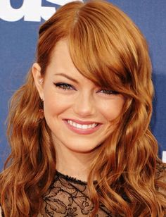 Top 20 Big  Hairstyles 3/20  Emma Stone shows off her fierce red hair with loose waves and long side bangs that frame her face perfectly.