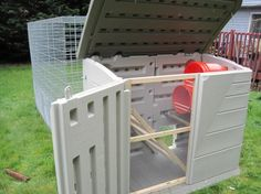 "Small chicken coop....I like the view of the inside, ladder rung for roosting and buckets for laying ""boxes"".  Door and top that opens for easy cleaning."