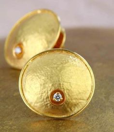 Minimalist textured gold ear studs at Rs.19,700 only at online in India.