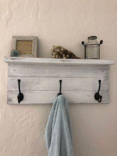 Distressed hand-painted rustic wood farmhouse shelf with black hooks Decor, Rustic Coat Rack, Wall Mounted Shelves, Wood Shelves, Shelves, Rustic Wood, Pallet Coat Racks, Primitive Decorating, Bathroom Decor