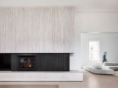 Travertine and limed white timber battens frame the fireplace at the Mornington Peninsula beach house. Beautifully captured by… Home Fireplace, Modern Fireplace, Fireplace Surrounds, Fireplace Design, Fireplaces, Beach House Furniture, Beach House Decor, Home Decor, Beach Houses