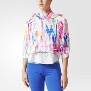 Fresh pops of color and bold patterns define this season's adidas STELLASPORT collection. A team effort between adidas and Stella McCartney, the line puts Stella's fun, youthful spin on favorite sportswear styles. The colorful tie-dye print and cropped, batwing shape of this women's pullover are design elements that are inspired by Stella. The jacket is made from breathable, water-repellent fabric with a droptail hem for extra coverage.