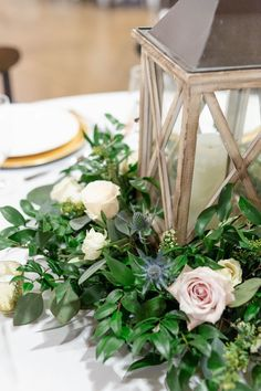 Lantern table centerpieces with greenery and flower accents. Garden style wedding flowers. Wooden table lanterns, lantern arrangements. Florals: Wildflowers LLC, Photography: Lindsey Fisher #weddings, #florals, #weddingflowers, #flowerarrangements, #weddi