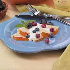 Crepes with Berries at www.tasteofhome.com  This is a 5 star recipe! I cannot wait to try this!