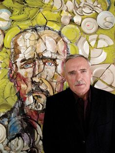 Dennis Hopper in front of his portrait by Julian Schnabel.  Oil, wax, bond and ceramic plates on wood.