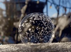"""Freezing temperatures can be miserable this time of year, but Angela Kelly has used it to capture a spectacular phenomenon on film. The Washington-based photographer and her young son brave the cold with a bubble wand and a camera to take pictures of bubbles freezing in a matter of seconds. The images below show the final freeze, but a GIF near the bottom shows the entire process. Kelly explains the experience: """"We blew the bubbles across the top of our frozen patio table and also upon the…"""