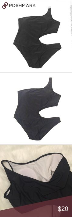 """Cut side bikini I am re-poshing this bikini, bc it is size Large, not M as was described and it does not fit me. Please verify dimensions: bust across: 19"""", hips:19"""", length from shoulder to bottom: 27"""". It has bust cups, and is super stretchy. It does not have a brand or fabric tag. Swim Bikinis"""