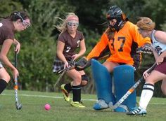 Bishop Stang goalie Jen Lee kicks back a shot on goal from Westport's Melanie Smeaton, left, in the second half of Tuesday's game. Coming in on the play are Westport's Kara Borges (7) and Bishop Stang's Colleen Packard.