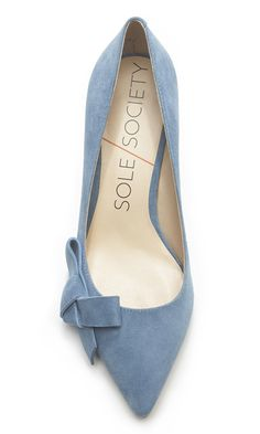 Lush chambray suede mid heel pump with a pointed toe and ladylike bow