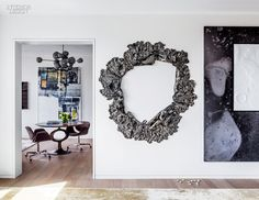An Art-Filled NYC Duplex by Steven Harris and Lucien Rees Roberts | A glazed porcelain wreath by Brie Ruais hangs in the living room. #design #interiordesign #interiordesignmagazine #projects #apartments