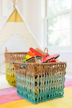 Ombre Rattan Baskets from The Land of Nod - fun, colorful playroom storage!