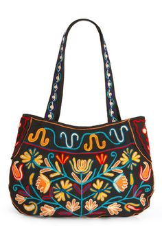 "Grow Your Own Way Bag.  This is another example of borrowing from the Eastern Woodland Indian style of beadwork.  These designs are very typical of the pre-1840s decorations found on ""possibles bags"" and Longhunter pouches of the time."