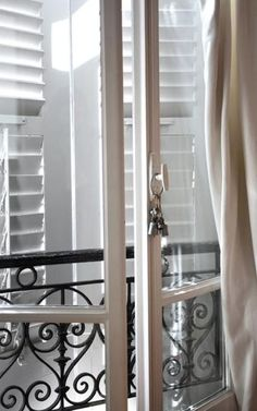 This looks exactly like my old flat in Paris - I love French windows - beautiful and practical. Parisian Apartment, Paris Apartments, French Windows, French Doors, French Balcony, Through The Window, Elegant Homes, Windows And Doors, Shutters