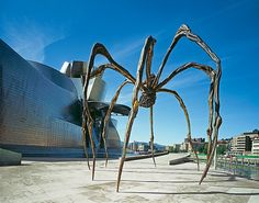 'Maman' : sculpture by the artist Louise Bourgeois. The sculpture, which resembles a spider, is amongst the world's largest, measuring over 30 ft high and over 33 ft wide, with a sac containing 26 marble eggs | 1999 - Bronze, marble, and stainless steel ~