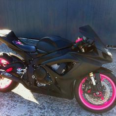 """""""2006 Suzuki GSXR 600!!! Matte/Flat black paint job w/ hot pink powder coated wheels and triple tree. Had one red & black...didn't scream girl bike though. Liked the reaction when people found out it was a WOMAN ridin it."""" - You go girl!"""
