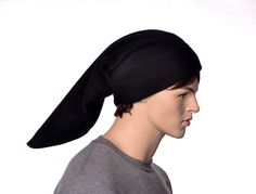 Long Black Elf Stocking Cap. Long black stocking cap made from fleece. Measures 2 feet long. Double Thick Headband Standard fits most adults with heads measuring 22-24 inches, Extra Large fits those with heads measuring 24-25 inches. Available plain or with large gold bell.