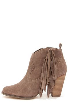 """The Steve Madden Ponncho Taupe Suede Fringe Ankle Boots are flirty with the fringe on top! Genuine leather suede constructs these adorable Western style booties that have a pointed toe, and fringe cascading along the side of a 4.5"""" shaft. Rounded collar has a pull tab at back, and a 4.5"""" zipper at the instep offers easy slip-on access. 3.5"""" stacked cone heel. Cushioned insole. Synthetic sole has nonskid markings. Available in whole and half sizes. Measurements are for a size 6. Leather upper. Balance man made materials. Imported."""