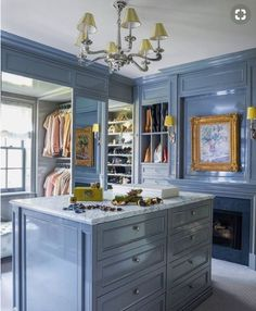 Walk-in closet and dressing area fitted with a beautiful chandelier and cabinet piece. This was part of a Manhattan townhouse project we had featured in ELLE Decor. Armoire Dressing, Dressing Room Closet, Closet Bedroom, Closet Space, Dressing Rooms, Master Closet, Dressing Area, Elle Decor, Estilo Hollywood Regency