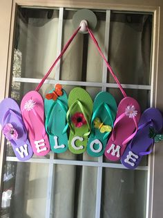 "Flip Flop Welcome sign. Directions: I bought 4 sets of sm flip flops from the dollar store. Glued them together with a hot glue gun. I also used some small plastic tubing I had hanging around to ""anchor"" it. You could use a small piece of would as well. I had wooden letters so I painted them white, you could simply write welcome on the flip flops or use card board paper. Glued the letters to the bottom. I then glued, again, glue gun, to the second flip flop in on each side for the ribbon to…"